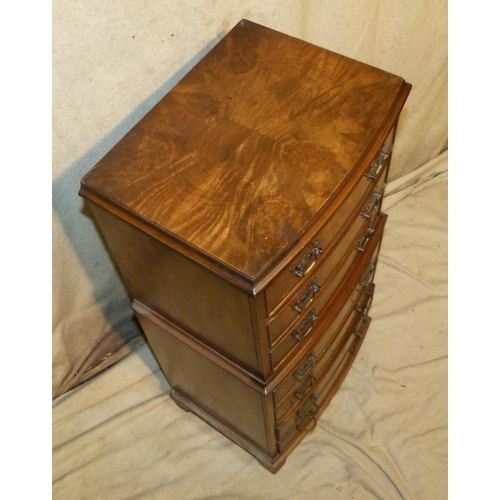 896 - A Reproduction Walnut Small Chest on Chest having 3 long graduated drawers above 4 further long grad...