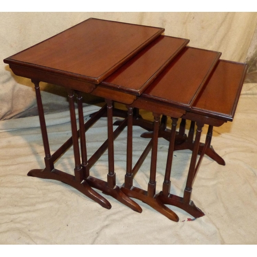 899 - A Quartetto Nest Of Rectangular Coffee Tables on round turned stems having splayed legs, largest 56c...