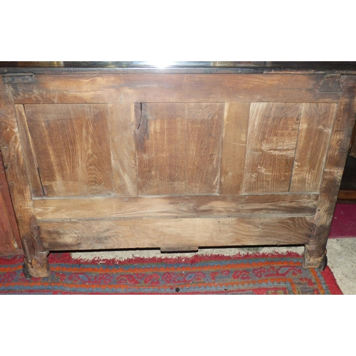 905 - An 18th Century Oak Mule Chest having hinged lid enclosing candle box, triple panel front with 2 dra...