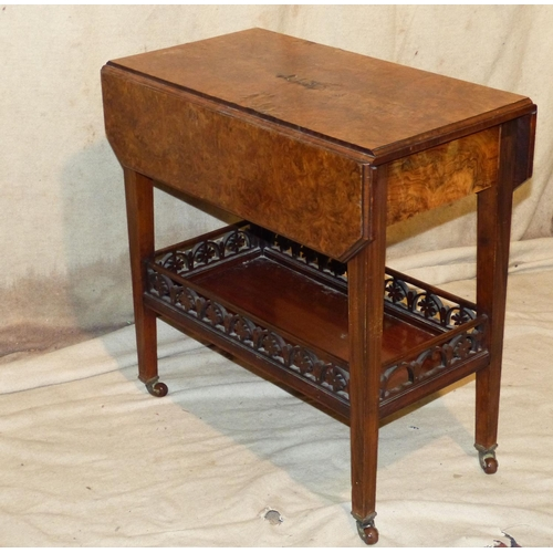 907 - A Burr Walnut Drop Leaf Tea Trolley on square tapering legs with galleried under tier, on china cast...
