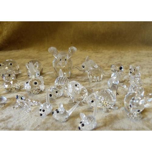 91 - 21 x Swarovski Animals, including elephant, rhino, hippo etc...