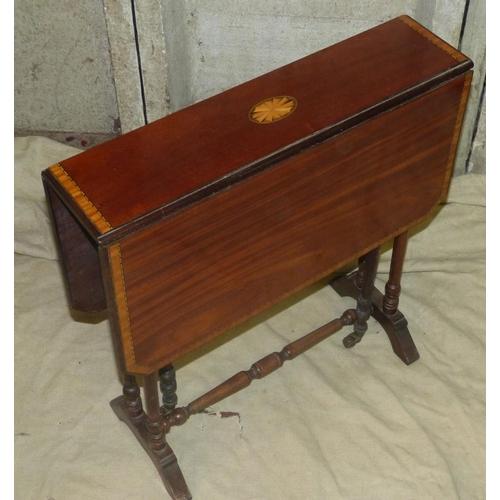 912 - An Edwardian Mahogany Sutherland Table having inlaid shell motif, banding and boxing, round turned l...