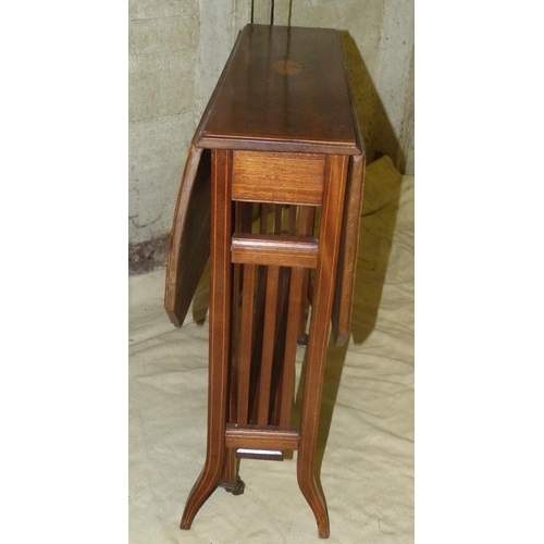 913 - A Larger Edwardian Mahogany Sutherland Table having chamfer corners, inlaid shell motifs with bandin...