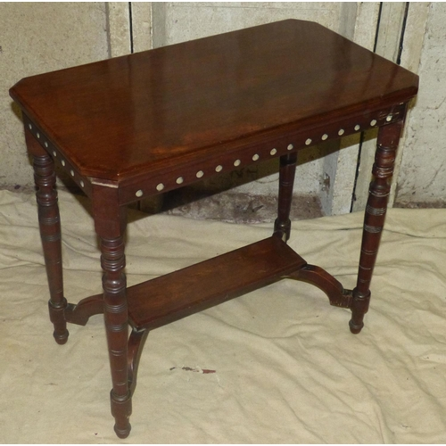 914 - A Mahogany Rectangular Shaped Occasional Table having chamfer corners on round turned legs with unde...
