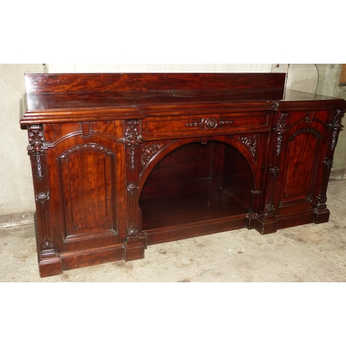 916 - A Victorian Mahogany Sideboard having lipped back, centre drawer above cubbyhole flanked by 2 arched...