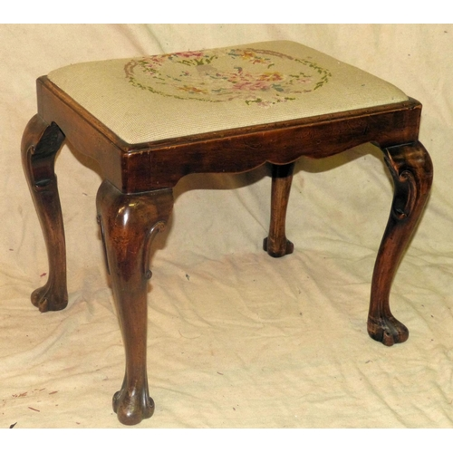 923 - A Walnut Dressing Table Stool having needlework drop-in seat on cabriole legs with claw feet, 58cm w...