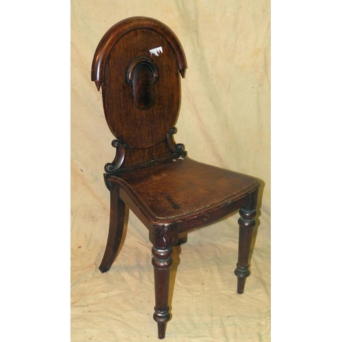 924 - A 19th Century Oak Hall Chair having arched top, solid seat on round turned legs...