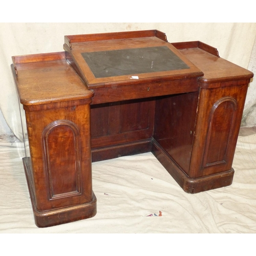 926 - A Victorian Kneehole Desk having sloping hinged top enclosing pigeon holes, gallery back and kneehol...