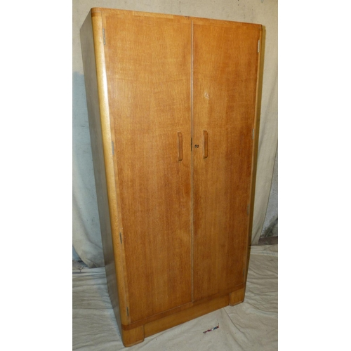 931 - Jordan & Cook Ltd, Worthing Light Oak Double Wardrobe having 2 panelled doors enclosing hanging, 92c...