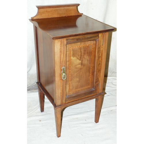 936 - An Edwardian Mahogany Bedside Cupboard having inlaid banding and stringing, lipped back, single pane...
