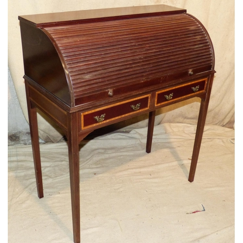 937 - A Mahogany Roll Top Desk having tambour front enclosing leather writing slope, drawers, pigeon holes...