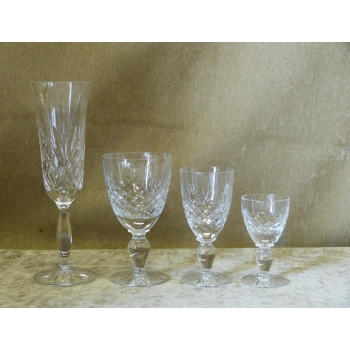 98 - A Set of 6 Cut Glass Champagne Flutes, a set of 6 small wine glasses, 6 x sherry glasses and 5 x oth...
