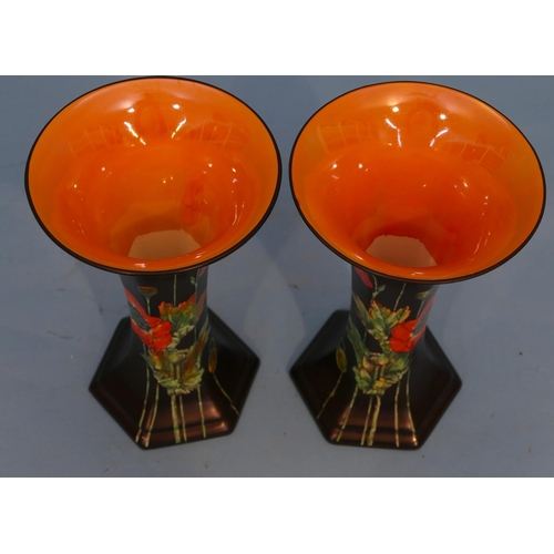 42 - A Pair of Crown Ducal Round Trumpet Shaped Vases on black and vibrant orange ground having poppy dec...