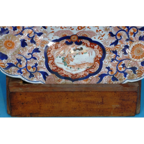 43 - A 19th Century Imari Large Oval Scallop Shaped Charger on white, blue and red ground, having all ove...