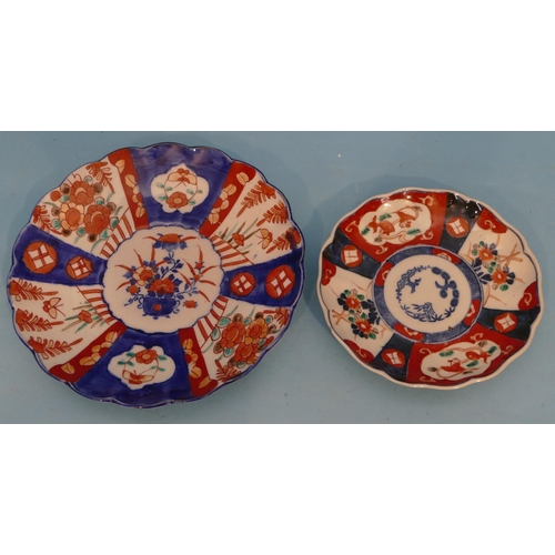 58 - An Imari Round Scallop Shaped Plate on white and blue ground with multicoloured floral, leaf and scr...