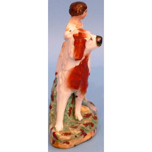 19 - A 19th Century Staffordshire Figure of a young girl seated upon a dog, 14cm high....