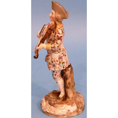 24 - A Continental China Figure of a gentleman playing a violin having all over floral and leaf decoratio...