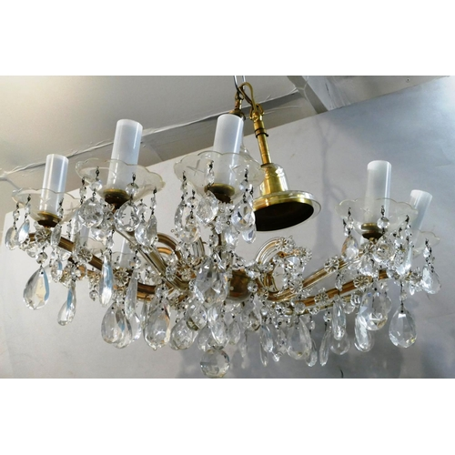 41 - A Glass 10 Light Chandelier with scroll shaped arms over lustre drops, 71cm wide, 55cm high (without...