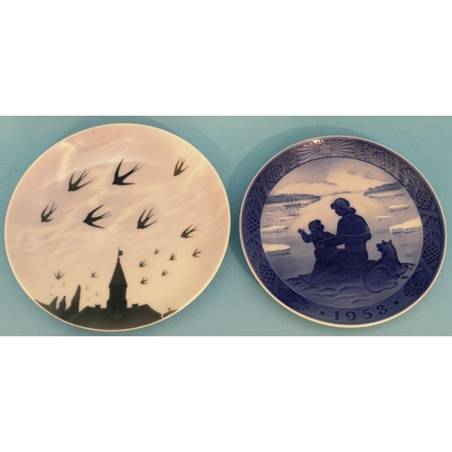 48 - A Royal Copenhagen Round Plate 545 depicting birds flying over rooftops, 20cm diameter, also a Royal...