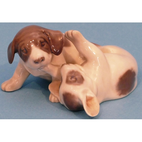 54 - A Royal Copenhagen Group of 2 puppies playing, 10cm long....
