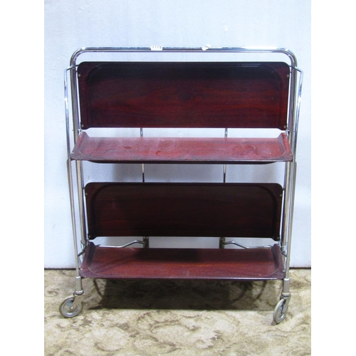 A Gerlinol Dinette three tier folding tea trolley,the tubular steel frame with laminated shelves,together with an oak stool in the Georgian style with upholstered rectangular seat raised on claw and ball supports and a machine woven tapestry of a h