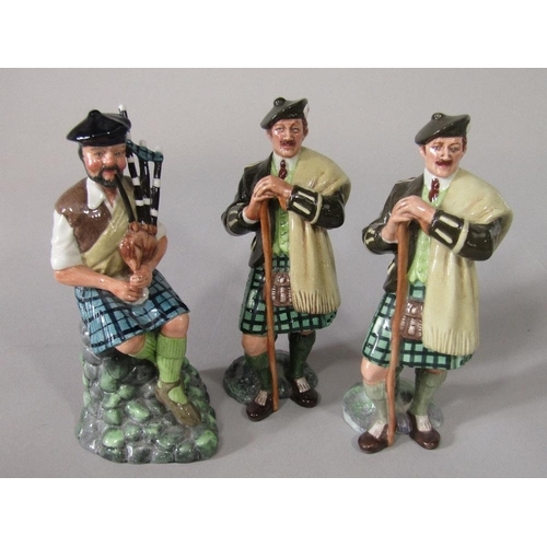 14 - A Royal Doulton figure of The Piper HN2907 together with two Royal Doulton figures of Laird HN2361 (...