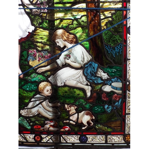 144 - Fine quality leaded stained glass panel depicting three children,with a terrier,gathering spring flo...