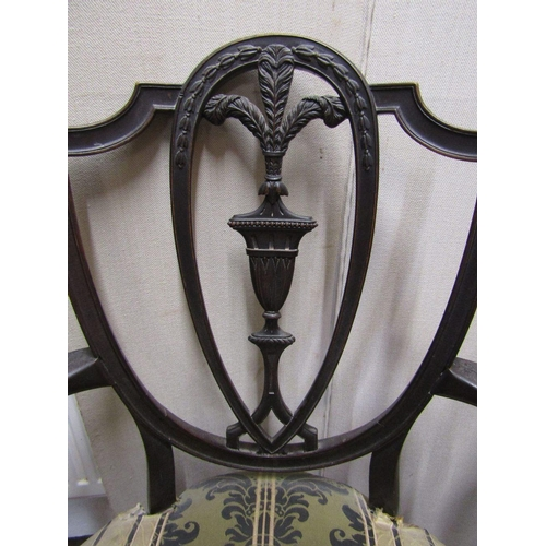 1456 - A Regency period open shield back elbow chair,the wide seat within swept arms,pierced shield back wi...