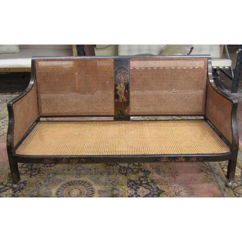 1458 - An Edwardian Bergere sofa in an 18th century manner with cane panelled back and sides,within lacquer...
