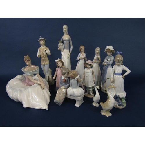 16 - A collection of Nao and similar figures including a seated woman in voluminous skirt,31 cm tall appr...
