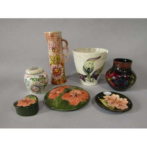 18 - A collection of Moorcroft ceramics including a vase in the anemone pattern with impressed marks to b...