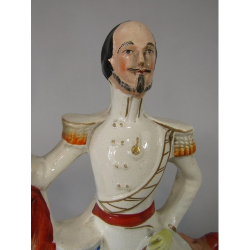 21 - A 19th century Staffordshire equestrian figure of the Duke of Cambridge 36 cm tall approx...