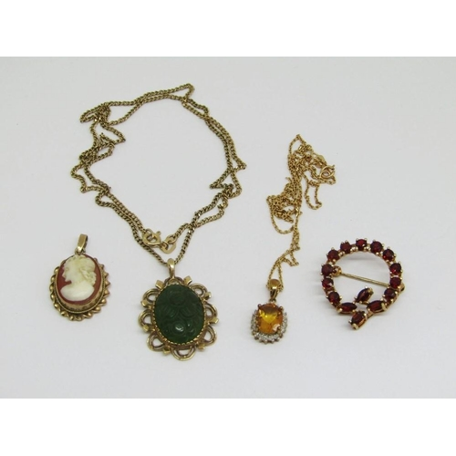 Mixed lot of 9ct jewellery comprising a garnet wreath brooch,a citrine and diamond cluster pendant necklace (chain clasp af),a further carved nephrite floral pendant necklace and a cameo pendant,14.3g total (4)