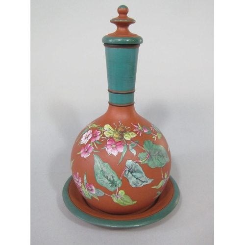 27 - A collection of 19th century and later ceramics including a terracotta bottle,stopper and stand with...