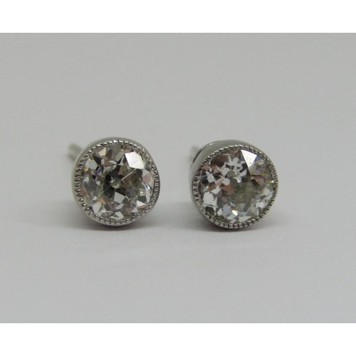 282 - Pair of diamond solitaire stud earrings,0.25cts each approx,millegrain set in unmarked white metal,0...