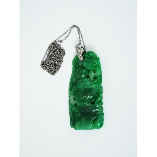 312 - Early 20th century carved jade pendant depicting a fish and frog on a lily pad,the white metal bale ...