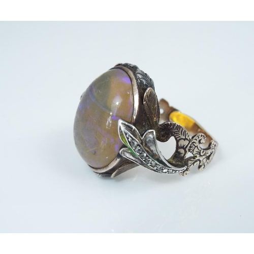 314 - 19th century cabochon opal and rose cut diamond ring,with ornately engraved shank and traces of gree...