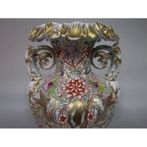 32 - An unusual mid 19th century two handled vase with relief moulded acanthus leaf detail and painted an...
