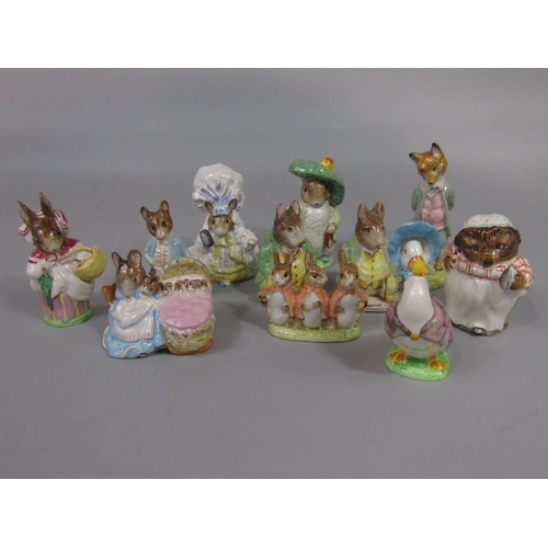 35 - A collection of Beswick Beatrix Potter figures including two Samuel Whiskers with brown back stamps,...