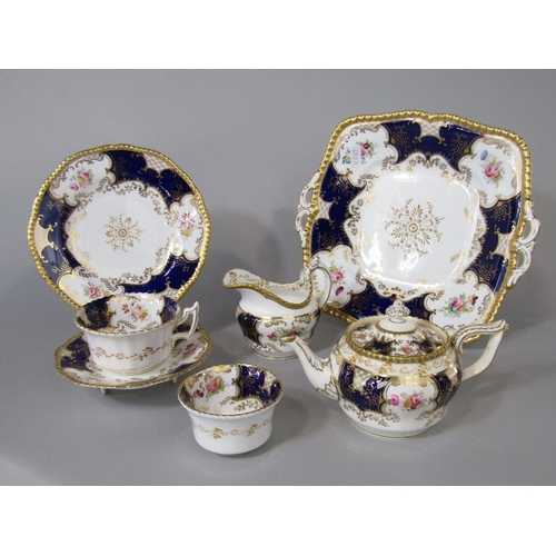 37 - A quantity of early 20th century Coalport teawares with floral decoration on a blue and gilt ground,...