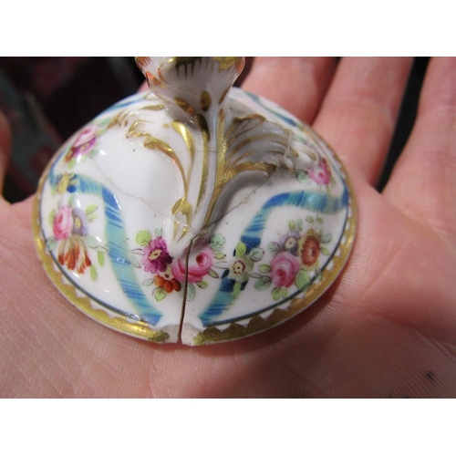 38 - An 18th century Worcester blue and white cup and saucer with painted floral sprays and with crescent...