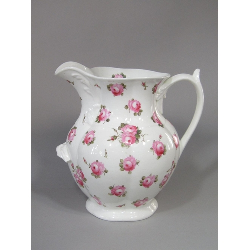 40 - A large 19th century ewer,possibly Coalport,with painted pink rose decoration and supporting handle ...