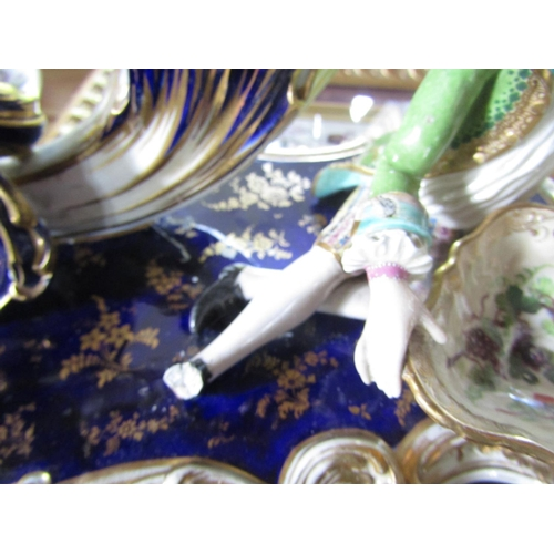 41 - A pair of good quality 19th century Minton two branch candelabra with blue and gilt scrolling and fl...