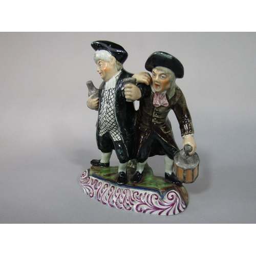 46 - A 19th century pottery figure group of the Vicar and Moses/or the Drunken Vicar,possibly of Scottish...