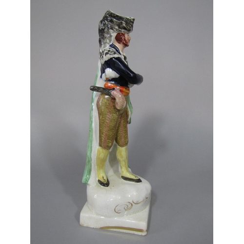 48 - A 19th century Staffordshire figure of a theatrical character in spotted green cloak,possibly repres...