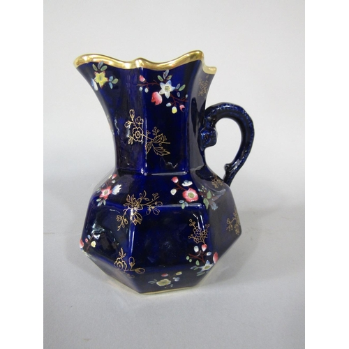 50 - A 19th century blue ground Masons ironstone jug of octagonal form with enamelled and gilt floral spr...