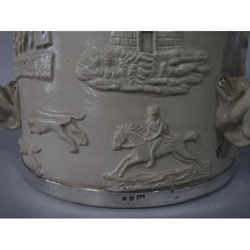 54 - A substantial 19th century relief moulded stoneware tyg with applied sprig decoration of hounds,Geor...