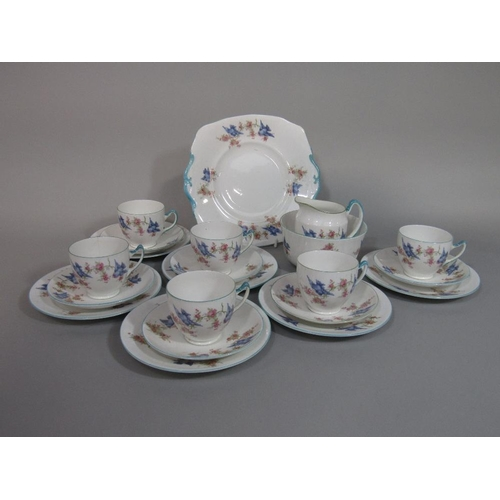 55 - A collection of Royal Albert Crown China teawares with blue bird and blossom detail comprising milk ...