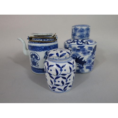 57 - An oriental blue and white caddy of circular form with painted fish decoration,with blue seal mark t...