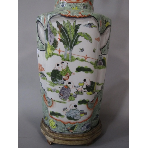 58 - A large oriental lamp base of lobed form with polychrome painted decoration incorporating flowers,fi...